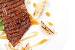 Roast steak boneless with roast onion Stock Photos