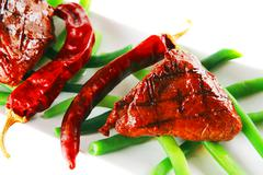 Roast fillet mignon with peppers Stock Photos