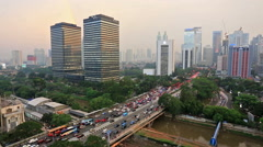 Sunset over heavy traffic in Jakarta, Indonesia capital city Stock Footage
