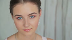 Portrait of pretty, young woman with beautiful make-up and elegant hairstyle Stock Footage