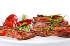 Meat slices on white dish Stock Photos