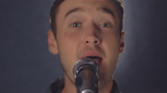 Vocalist performs with pop group Stock Footage