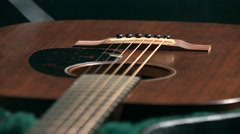 Brown classic guitar in the case. 4K racking focus video Stock Footage