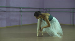 Young ballerina wears her pointe shoes Stock Footage