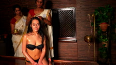 White woman having professional head treatment. Indian masseuse in spa salon. Stock Footage