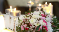 Flower and candle decorations on wedding tables Stock Footage