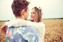 Happy smiling young hippie couple outdoors Stock Photos