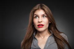 Shocked girl with wide opened eyes Stock Photos