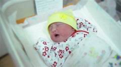 New born infant asleep in the blanket in delivery room, baby girl crying Stock Footage