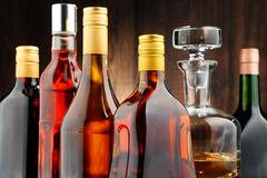 Composition with bottles of assorted alcoholic beverages. Stock Photos