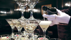 The Waiter in white gloves at the Champagne Glass Tower background Stock Footage
