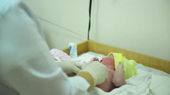 New born baby in hospital, Pediatrician and infant child with a bokeh background Stock Footage