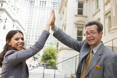 Professional Man and Woman High Five Kuvituskuvat