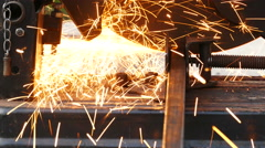 Cutting of a metal pipe with splashes of sparks Stock Footage
