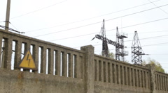 Thermal power. Sign of high voltage on the fence in front of the concrete plant Stock Footage
