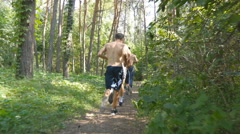 Fit handsome athletic male sportsmens working out. People training. Rear view Stock Footage