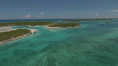 Aerial view of exotic island with buildings and piers for yachts, Exuma, Bahamas Stock Footage