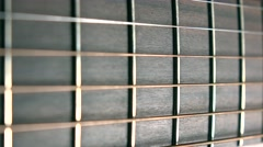 Guitar fret and six strings, shallow focus. Music performance. 4K macro dolly Stock Footage