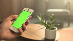 White Phone in Left Hand Bright Stock Footage