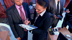 Group business people men and women in office. Used dolly system Stock Footage