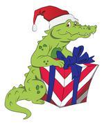 Vector of santa crocodile with giftbox. Stock Illustration