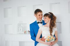 Young bride and groom in interior design studio Stock Photos