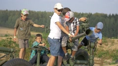 Children playing with military vehicles of World War II Stock Footage