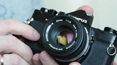 An old 35mm film camera - film rewind Stock Footage