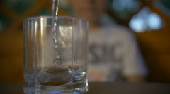 Pour the drink into a glass, boy takes a glass and drinks a soda, boy in a cafe Stock Footage