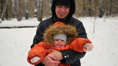 Father spinning child in winter Park Stock Footage