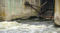 A dirty brown muddy water flows over the dam Stock Footage