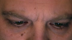 Eyes of serious frowning caucasian man using his tablet computer. Screen Stock Footage