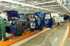 Cherkasy, Ukraine - May 29, 2012: Iron cars frameworks at the factory for the Stock Photos
