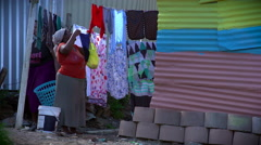 African woman hang up washing Stock Footage