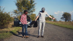 Diverse friends having car trouble walk together Stock Footage