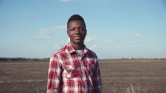 Handsome smiling black man wearing plaid shirt Stock Footage