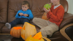 Two little boys are preparing to Halloween party Stock Footage