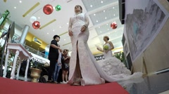 Model with wedding dress clapping on bridal fair Stock Footage