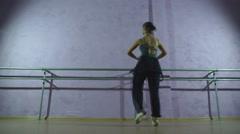 Beautiful ballet dancer training near the ballet barre in a ballet class Stock Footage