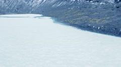 Aerial shot of glacier frozen lagoon Stock Footage
