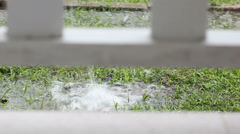 Hard rain falling on the ground from the roof of a house. Stock Footage