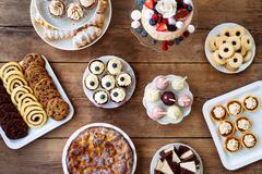 Table with cake, pie, cupcakes, cookies, tarts and cakepops Stock Photos