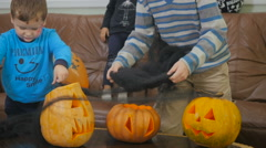 Two boys and girl play with spiderweb on Helloween Stock Footage