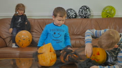 Two little boys play with spiderweb on Halloween Stock Footage