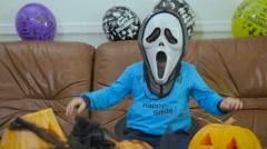 Boyin terrible mask try to scary on Halloween Stock Footage