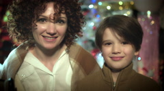 4k Christmas and New Year Holiday Woman Kissing her Son Arkistovideo