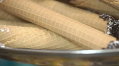 Sweet wafer rolls with cream and chocolate, close-up Stock Footage