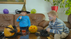 Two little boys have a good time on the Halloween Stock Footage