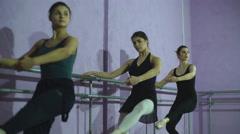 Ballerinas Practicing At Ballet Barre In Dance Studio Stock Footage