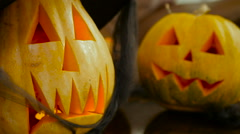 Two pumpkins with carved face on the Halloween Stock Footage